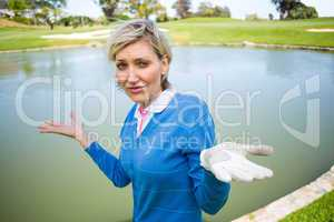 Confused female golfer looking at lake