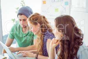 Fashion students looking at computer