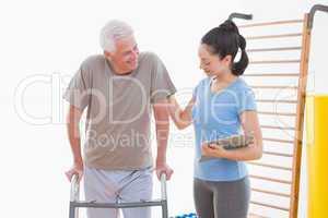 Coach encouraging senior man