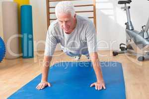 Senior man in plank position