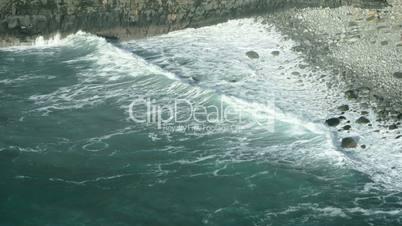 Wave breaking against cliff in Ireland