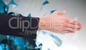 Composite image of close up of businessman offering handshake