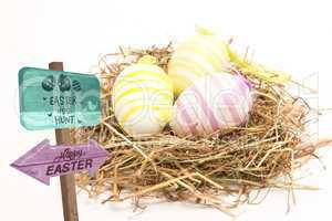 Composite image of easter egg hunt sign
