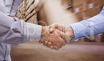 Composite image of men shaking hands