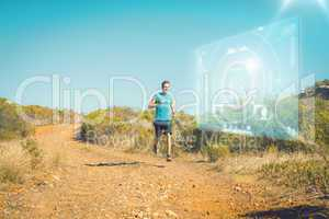 Composite image of athletic man jogging on country trail