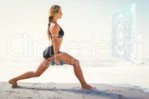 Composite image of fit blonde doing weighted lunges on the beach