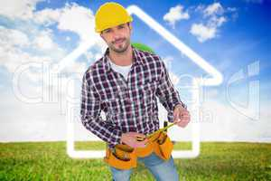 Composite image of smiling handyman holding tape measure