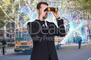 Composite image of elegant businessman standing and using binocu