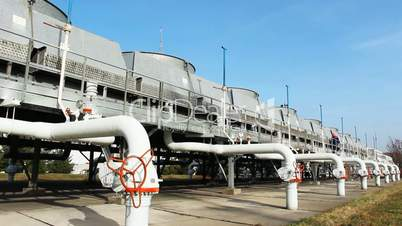 worker comes along top installation at gas compressor station