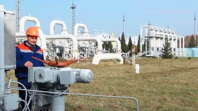 worker opens recirculation valve on compressor station