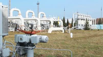 worker closes recirculation valve on compressor station