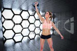 Composite image of female crossfitter lifting up kettlebell