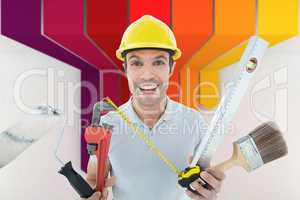 Composite image of portrait of happy worker holding various equi