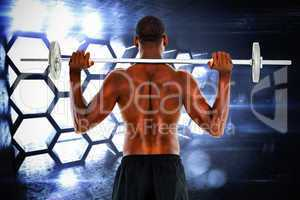Composite image of rear view of a fit shirtless man lifting barb