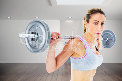 Composite image of strong female crossfitter lifting barbell beh