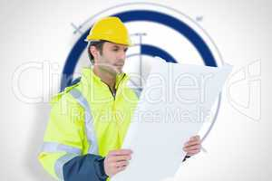 Composite image of architect analyzing blueprint over white back