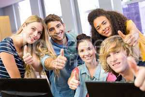 College students gesturing thumbs up
