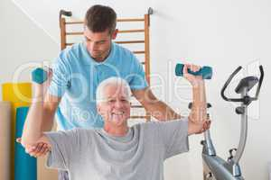 Senior man working out with his trainer