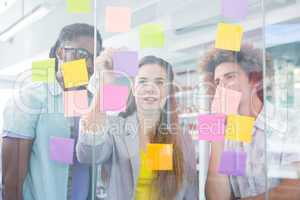 Creative team writing on adhesive notes