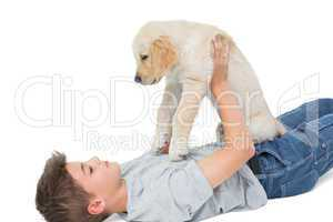 Boy playing with puppy