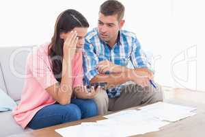 Couple calculating home finances together