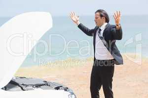 Anger businessman looking at engine