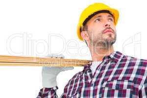 Handyman holding wood planks