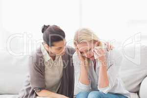 Patient crying next to her therapist