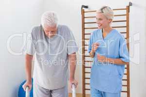 Therapist encouraging senior man