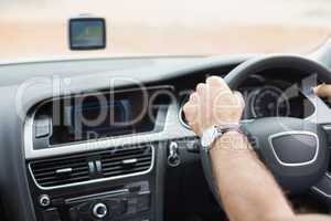 Man driving with satellite navigation system