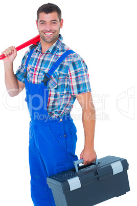 Happy repairman with toolbox and monkey wrench