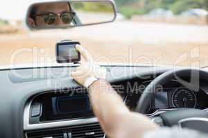 Man using satellite navigation system