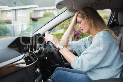 Worried woman sitting in drivers seat