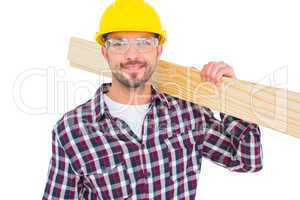Handyman holding wood planks