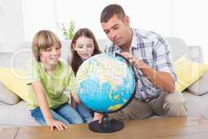 Family exploring globe