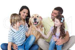 Family stroking dog