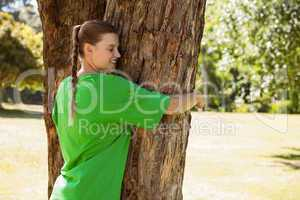 Environmental activist hugging a tree in the park