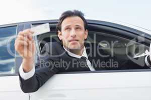Businessman showing his driver license