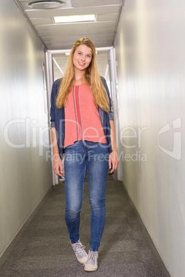 Female student standing at college corridor