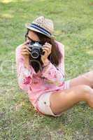 Pretty brunette with retro camera