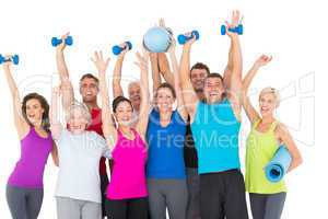 Excited people with exercise equipment raising hands