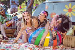 Happy hipsters having fun on campsite