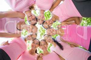 Smiling women organising event for breast cancer awareness