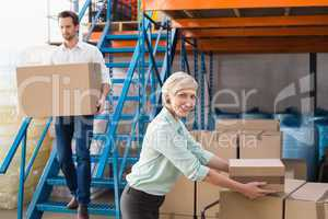 Warehouse managers loading a trolley