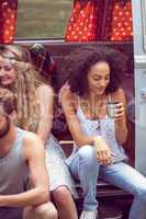 Hipster friends in camper van at festival