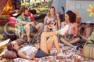 Happy hipsters relaxing on campsite