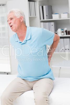 Senior man screaming due to back pain