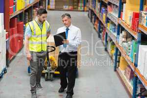 Warehouse worker talking with his manager