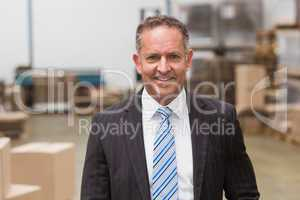 Portrait of a smiling boss standing