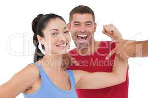 Fit woman and trainer smiling at camera